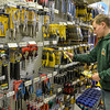 DESI SMITH/Staff photo.     Brian Bos stocks the tool isle at the Building Cernter as part of the Gloucester High School Transition Program, which is a partnership with Cape Ann Business for students who are not going on to higher education. May 1,2014
