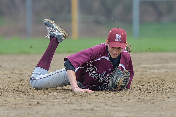 DESI SMITH/Staff photo.  Rockport's Short stop Hayden Roller #14 catches a low line drive to end the inning against Ipswich Saturday morning at Mile Lane Park in Ipswich. May 10 ,2014