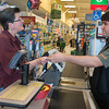 DESI SMITH/Staff photo.    Jonathan Taormina who works the register at the Shaws on Eastern Ave, hands Teresa Milne of Rockport her slip while her groceries are being bagged. Jonathan is part of the Gloucester High School Transition Program, which is a partnership with Cape Ann Business for students who are not going on to higher education. May 1,2014