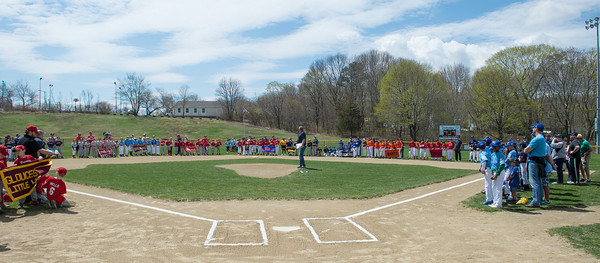 DESI SMITH/Staff photo.    Billy Melvin, Director of the Little League,stands at the pichers mound and delivers his opening comments to a large crowd, as player line the infield at Boudreau Field Saturday morning after the Gloucester Little League Parade.  May 3,2014