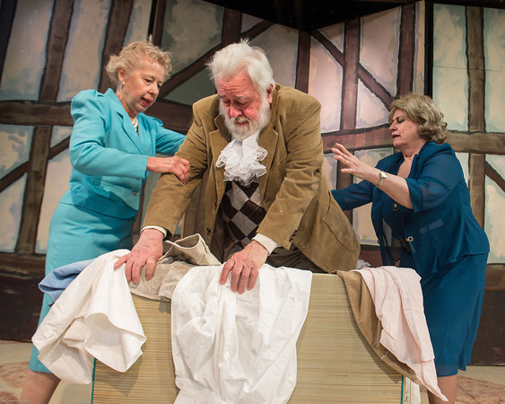 """DESI SMITH/Staff photo.   Annegret Reimer (left) Mistress Ford, Ray Jenness, Falstaff and Linda Stiegler, Mistess Page, act out a scene in a rehearsal for """"The Merry Wives of Windsor"""" Monday night at the Gloucester Stage Company. The plays start May 8, 9, 10, 15, 16, 17, at 8 PM; May 11 and 18 at 3 PM at the Gorton Theatre (home of Gloucester Stage Company) 267 East Main Street. Tickets are $15 general admission, $10 student, and $5 youth under nineteen and may be purchased at the door or reserved at cast2008@prodigy.net  May 5,2014"""