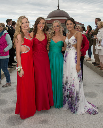 DESI SMITH/Staff photo.  Prom goer's from left to right, Olivia Keating, Katie Bernier, Leah Saunders and Miyen Chang, show off their gowns Friday afternoon at Tucks Point before heading off to prom night.  May 30 ,2014