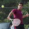DESI SMITH/Staff photo.   Gloucester's Victor Tanala returns the ball against Somerville's Damon L, Thursaday afternoon in the Div. 2 North First Round 1st singles, at Gloucester High School. May 29,2014