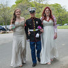 DESI SMITH/Staff photo.  LCPL Hugh Mosher escorts Abby Buck (left) and his date Hope Kincaid after arriving at Tucks Point on prom night for photos Friday afternoon .  May 30 ,2014