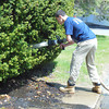ANDREA HOLBROOK/Staff photo<br /> High school student Brett Souza of Gloucester, an intern with the Gloucester Fire Department, mans the hose as firefighters extinguish a mulch fire in front of the Gloucester Daily Times building at 36 Whittemore St. on Thursday shortly before noon. May 15, 2014.