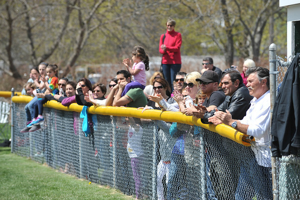 DESI SMITH/Staff photo.    Family and friends line the fence to watch opening day at Boudreau Field Saturday morning after the Gloucester Little League Parade.  May 3,2014