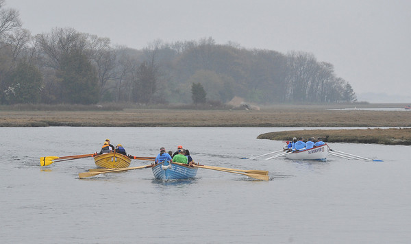 DESI SMITH/Staff photo. Three teams push hard as they fight for second place, coming up to the finish in the Essex River Race, a 5.5-plus mile open water event that loops behind the barrier beaches of Ipswich and back through one of the most scenic tidal areas in New England, Saturday morning in Essex.   May 10,2014