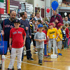 DESI SMITH/Staff photo.  Parents and their kids wait in line for their chance to have their photo taken with the Red Sox World Series Trophy Saturday Morning at the Benjamin A. Smith Fieldhouse.<br />  May 17,2014