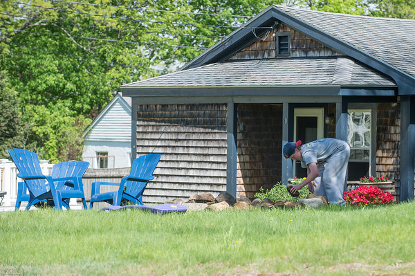 DESI SMITH/Staff photo.   Paul DiFluri 14, of Essex builds a fire pit from rocks that his mom let him take from her garden at their home on Western Ave Saturday morning. <br /> Paul wanted to build it for a party they were having that evening.<br />  May 17,2014
