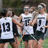 DESI SMITH/Staff photo.   Manchester Essex's                 #9 is congratulated after scoring a goal against Ipswich by teammates Maya Heath #13 and Liddy DeConto #15 late aftenoon Friday at Hyland Field at MERHS.   May 9,2014