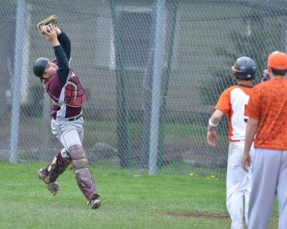 DESI SMITH/Staff photo.  Rockport's catcher Kyle Nelson catches a pop up by Ipswich batter #5 Saturday morning at Mile Lane Park in Ipswich. May 10 ,2014