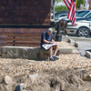 DESI SMITH/Staff photo.  Ernie Doucette of Essex, relaxes along the river side next to Tom Shea's reading his paper Saturday morning. Ernie was expecting a rain day, but was happy to get out and enjoy the sunshine.<br />  May 17,2014
