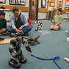 DESI SMITH/Staff photo.   Nora Prist (left) with as her son Joshua 9, takes a turn controling some robots using a remote control, along with Ana Tarason 9, of Gloucester (right) Saturday afternoon in the Gloucester schools arts festival, were diffferent activites were held, at the Hive,City Hall and the Sawyer Free Library. The robots were brought there by John Madama, a science specialist for the Pre-K-5 schools.  May 10,2014