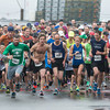 DESI SMITH/Staff photo. Runners take off in the Motif#1 Day 5k Road Race Saturday morning a T-Wharf in Rockport.<br />  May 18,2014