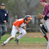 DESI SMITH/Staff photo.  Rockport's Conor Kuykendall #6 looses the ball when trying to tag out Ipswich's Mike Savoie caught in a run down between second and third Saturday morning at Mile Lane Park in Ipswich. May 10 ,2014