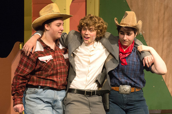 DESI SMITH/Staff photo.  Jack Favazza (center) is supported by cast members Danielle Creer,(left) and Diana DiLiberti, after drinking to much, in Crazy in for You, Wednesday night at the Gloucester High School.  May 8,2014