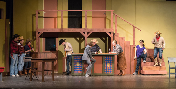 DESI SMITH/Staff photo.    From left to right, Rose Rome, Danielle Creer, Diana DiLiberti, Alan Davis, Jack Favazza (in suit), Hannah Sears, Mikayla Healey (in tan skirt), Emily Moore, and Amy Geraghty, act out a bar scene during a dress rehearsal in Crazy for You, Wednesday night at the Gloucester High School.  May 8,2014