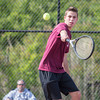 DESI SMITH/Staff photo.   Gloucester's Colin Sweet returns the ball against Somerville's Brazeen Ranjit, Thursaday afternoon in the Div. 2 North First Round 3rd singles , at Gloucester High School. May 29,2014