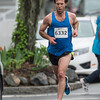 DESI SMITH/Staff photo.  Chris Blondin heads the the finish, placing first for the men with a time of 16:45.4 in the Motif#1 Day 5k Saturday morning a T-Wharf in Rockport.<br />  May 18,2014