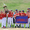 DESI SMITH/Staff photo.    The Cardinals,last years Major A World Series Champions,show of their trophy as their team was introduced during a ceremony at Boudreau Field, after the Gloucester Little League Parade Saturday morning in Gloucester.  May 3,2014