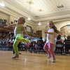 DESI SMITH/Staff photo.    Anita Burns 5, (left) and Marille Lusk 4, kick up their heals as the Gloucester High School Docksiders perform at city hall Saturday afternoon in the Gloucester schools arts festival, were diffferent activites were held, at the Hive,City Hall and the Sawyer Free Library.   May 10,2014