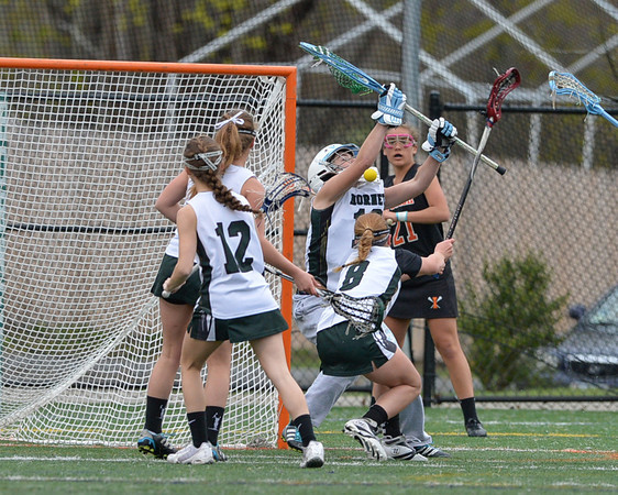 DESI SMITH/Staff photo.   Manchester Essex's Goalie Katie         #18 makes a stop against Ipswich, late aftenoon Friday at Hyland Field at MERHS.   May 9,2014