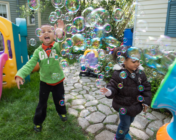 DESI SMITH/Staff photo.   Brandon Griffin 6, and Carla Kacer 3, both of Gloucester, have some fun with a bubble machine while at Hyacinth Family Day Care on Centennial Ave Thursday afternoon.   May 29,2014