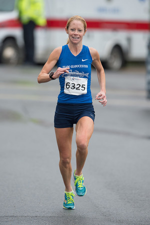 DESI SMITH/Staff photo.   Rockport's Layce Alves, smiles as she headsto the finish, placing first for the women with a time of 18:39.5 the Motif#1 Day 5k Saturday morning a T-Wharf in Rockport.<br />  May 18,2014