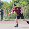 DESI SMITH/Staff photo.   Gloucester's Connor Adkins returns the ball against Somerville's Navdeep Maini, Thursaday afternoon in the Div. 2 North First Round in 2nd singles, at Gloucester High School. May 29,2014