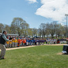 DESI SMITH/Staff photo.   Randy Burns throws out the first pitch to his father Bob Burns, Saturday morning at Boudreau Field after the Gloucester Little League Parade.<br /> Randy was injured in a fall, and was a gifted athlete, playing all through Little League, becoming captain of the high school baseball team and played for the Legion. Randy still umpires the Little League games as he has done for 12 years now.<br />   May 3,2014