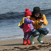 Rockport:  Annika Barrett, 2, of Rockport compares seaweed with her mom Heidi while walking Front Beach Saturday morning.  According to her mom Annika loves to go to the beach so they make sure they go any day the weather is remotely nice. Mary Muckenhoupt/Gloucester Daily Times