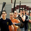 Gloucester: Evan Goss, front, spins his rifle as he rehearses drill demonstrations with the Gloucester JROTC at the Benjamin A. Smith fieldhouse after school. JROTC members will be traveling to Pennsylvania for a competition on April 4th. Photo by Kate Glass/Gloucester Daily Times Monday, March 3, 2009