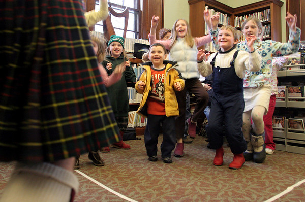 Manchester: Children dance along with Jeremy Bell, left, during the Celtic Bells family concert held at the Manchester Public Library Saturday afternoon. The Celtic Bells, Nancy and Jeremy Bell and their two children Calum and Katriona, together provided an array of Irish entertainment including, Irish Jigs and step dances, songs and storytelling and the playing of many musical instruments. Mary Muckenhoupt/Gloucester Daily Times