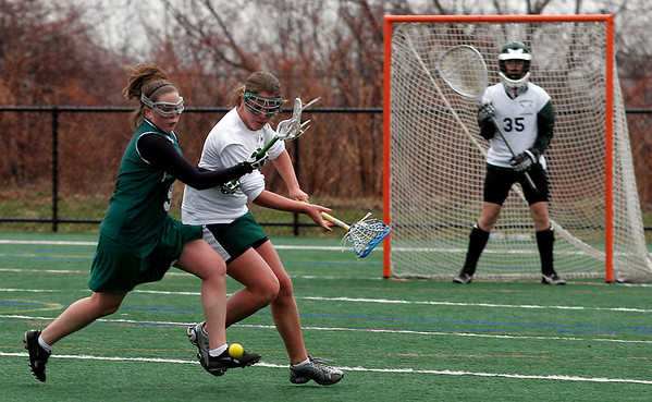 Manchester: Pentucket's KC Jones, left, and Manchester Essex's Shane Gordon battle for a loose ball during their game at Coach Ed Field Field yesterday afternoon. The Hornets won 12-11. Photo by Kate Glass/Gloucester Daily Times Monday, March 30, 2009