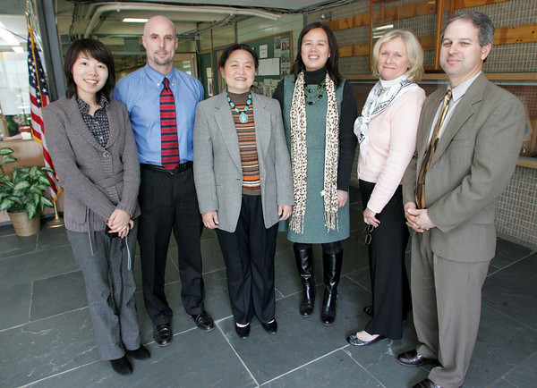 Manchester: From left, Tanya Zho, Principal James Lee, Hun Su, Xiaobai Wang, Sharon Maguire, chairperson of school counseling, and Assistant Principal Paul Murphy met at Manchester Essex High School Friday to talk about building a partnership with a high school in the Hunan province in China . Mary Muckenhoupt/Gloucester Daily Times