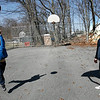 Rockport: Kyle Beal, 6, tries to sink a basket as his father, Eric Beal, watches at the Story Street Playground on Tuesday afternoon. The two were playing with Kyle's first NBA sized basketball. Photo by Kate Glass/Gloucester Daily Times Tuesday, March 31, 2009