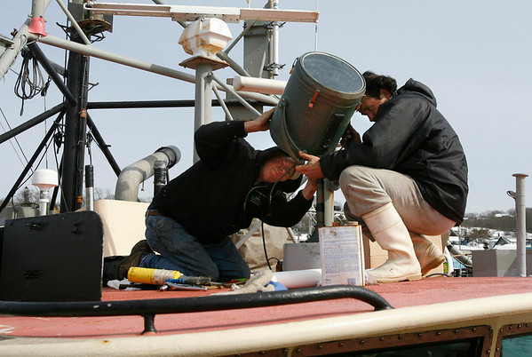 "Gloucester: Brian Walker and ""Slava"" repair the search light on the Michael & Kristen while it is docked at the Jodrey State Fish Pier. The crew was hoping to get it repaired so they could go out to fish on Wednesday. Photo by Kate Glass/Gloucester Daily Times Tuesday, March 10, 2009"