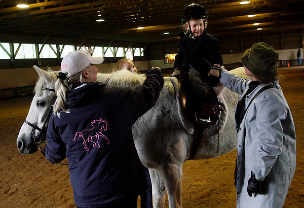Rockport: Luke Bannerman smiles at his mom while getting ready to ride Skye during the leadline portion of the Sandy Bay Stables Horse Show yesterday afternoon. The show consisted of dressage tests, jumping, and games. Photo by Kate Glass/Gloucester Daily Times Sunday, March 29, 2009