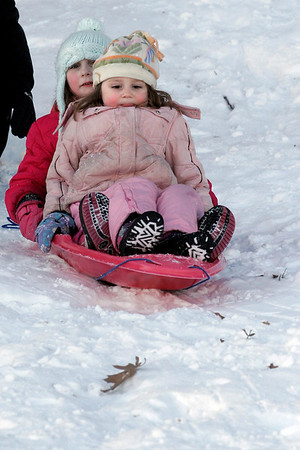 Rockport: Robin and Piper Englin go sledding at Evans Field yesterday afternoon. The two recently moved to Rockport from Florida and are loving their first snowy winter. Photo by Kate Glass/Gloucester Daily Times Tuesday, March 3, 2009