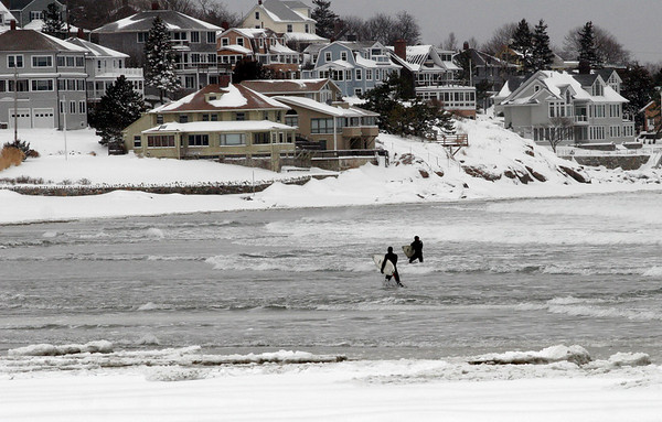 Gloucester: Two surfers head to shore after riding the waves of yesterday's storm at Good Harbor Beach. Photo by Kate Glass/Gloucester Daily Times Monday, March 2, 2009