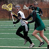 Manchester: Manchester Essex's Lee Stroman looks for an open teammate as Pentucket's Kayla Jewitt tries to knock the ball out of her stick during their game at Coach Ed Field Field yesterday afternoon. Photo by Kate Glass/Gloucester Daily Times Monday, March 30, 2009