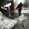 Gloucester: Marco Silva shovels slush away from the entrance to Steve Connolly Seafood Company, Inc. yesterday morning. The combination of rain, sleet, and snow made for some heavy lifting. Photo by Kate Glass/Gloucester Daily Times Monday, March 9, 2009