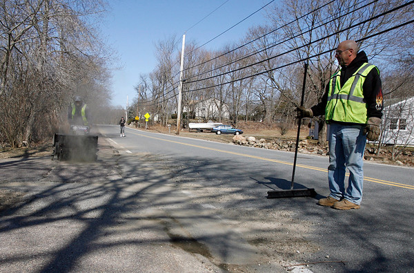 "Essex: Essex DPW employee Bob Viselli watches as co-worker Ken Stanton uses a power sweeper to clear the sidewalks along Western Ave in Essex yesterday afternoon. ""Sweeping dust is better than pushing snow,"" Viselli says. Photo by Kate Glass/Gloucester Daily Times Tuesday, March 17, 2009"