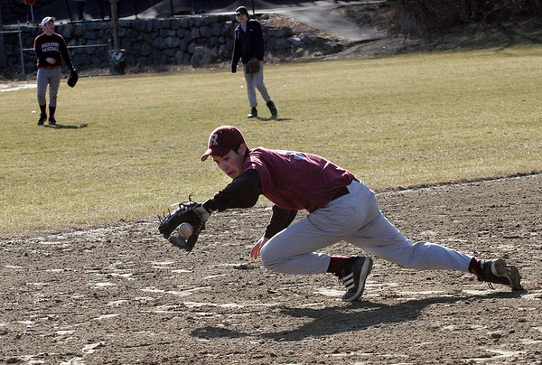 Rockport: Mike Emerson makes a diving catch during the Rockport baseball team's first practice outside yesterday. Emerson is one of the co-captains of the varsity team. Photo by Kate Glass/Gloucester Daily Times Tuesday, March 17, 2009