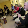 Gloucester: Dave Sidon, right, keeps the beat on his djembe drum while partaking in a West African Drumming Group at the Lanesville Community Center Wednesday night.  The group meets on Wednesdays for the next 5 weeks from 7 to 8:30 p.m.. During each session students can learn West African rhythms and how to playfully improvise and solo on djembe and dunun drums. Mary Muckenhoupt/Gloucester Daily Times