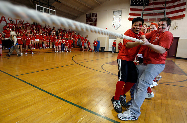 Rockport: Rockport High School seniors Tony Tran, left, and Clayton Morrissey, right, lead their classmates in a tug of war competition during the final day of Spirit Week yesterday. The students all dressed up in their class colors and competed in tug of war, limbo, and a mural contest. Photo by Kate Glass/Gloucester Daily Times Friday, March 13, 2009
