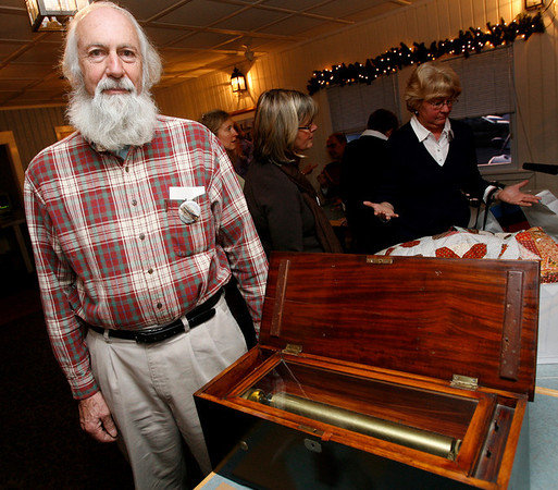 Essex: Steve Willard of Marblehead displays a music box that was appraised between $1,500 and $2,000 during Essex Antique night at Periwinkles. Photo by Kate Glass/Gloucester Daily Times Thursday, March 19, 2009