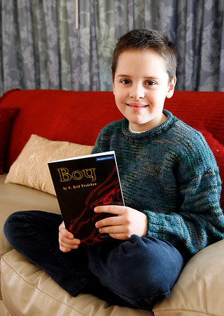 "Gloucester: Reid Bradshaw, 9, of Gloucester, recently completed ""Boy,"" the first of a series of books for young readers. Bradshaw created a written dragon language for the book, which also contains a glossary of difficult words. Photo by Kate Glass/Gloucester Daily Times Wednesday, March 18, 2009"