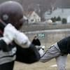 Gloucester: Gloucester junior Lucas Ilges pitches a ball to Jimmy Nicoloisi during baseball practice at Nate Ross Field Thursday afternoon. Mary Muckenhoupt/Gloucester Daily Times