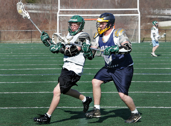 Manchester: Manchester Essex juniors Colin Lyne, left, and Jack Bishop run drills during lacrosse practice at Ed Field Field Friday afternoon. Mary Muckenhoupt/Gloucester Daily Times